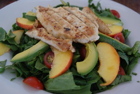 Spinach salad with long island peaches, avocado, cherry tomatoes and white balsamic dressing